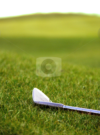 Golfclub on the Fairway stock photo, Closeup of an iron golfclub on the fairway grass by Niklas Ramberg