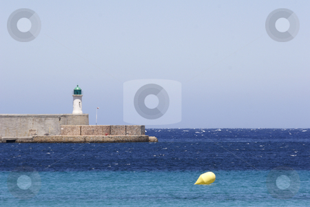Light house on harbor entrance corsica stock photo, Lighthouse on port entrance to  corsica island by Mark Yuill