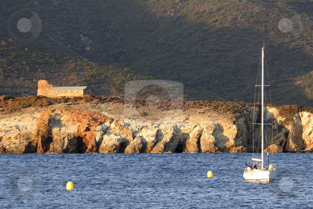 Sailing yacht at anchor evening Corsica stock photo, Sailing yacht at anchor evening time Corsica by Mark Yuill