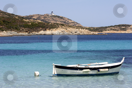 Traditional Corsican fishing boat anchored in bay corsica stock photo, A Traditional Corsican fishing boat anchored in bay corsica by Mark Yuill