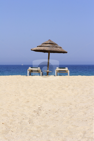Sun lounger on empty sandy beach stock photo, Sun lounger on empty sandy beach in Corsica France by Mark Yuill