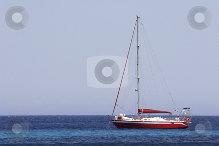 Sailing yacht at anchor in bay Corsica stock photo, A modern sailing yacht at anchor in bay Corsica by Mark Yuill