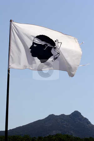 Corsica flag with mountains in background stock photo, Corsica flag with mountains in background, Corsica, France by Mark Yuill