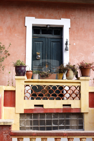 Traditional painted entrance in Calvi Corsica stock photo, Traditional painted entrance with plant pots in Calvi Corsica by Mark Yuill