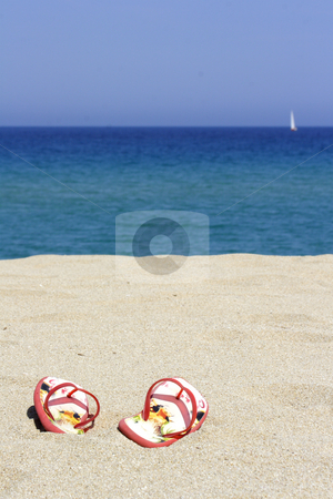 Flips flops on an empty sandy beach stock photo, Flips flops on an empty sandy beach, Corsica, France by Mark Yuill