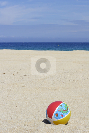 Beachball on empty sandy beach stock photo, A beachball on empty sandy beach in Corsica by Mark Yuill