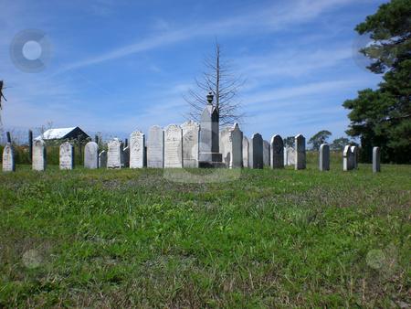 Ground level gravestones stock photo,  by J.G. Byers