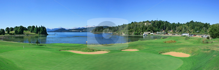 Golf course stock photo, Playing golf by the lake in the summer by Rafael Franceschini