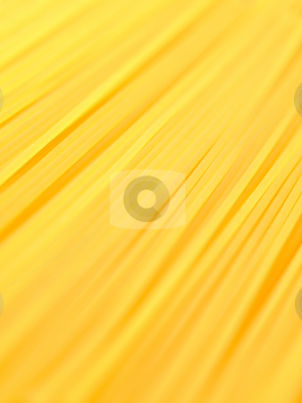 Uncooked Italian pasta Spaghetti background stock photo, Uncooked Italian pasta spaghetti with selective focus by Laurent Dambies