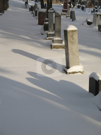 Snow on a cemetery stock photo, Snow on a cemetery by Mbudley Mbudley
