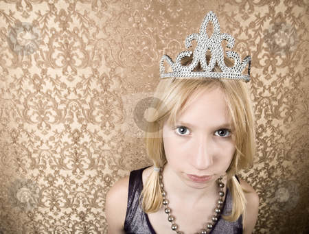 Pretty young girl with a tiara pouting stock photo, Portrait of pretty pouting young girl wearing a tiara by Scott Griessel