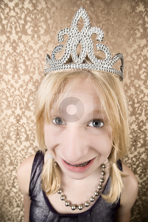 Pretty young girl with a tiara with braces stock photo, Portrait of pretty young girl with braces wearing a tiara by Scott Griessel