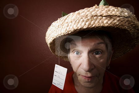 Senior woman in a cheap straw hat stock photo, Senior woman in a red shirt and cheap straw hat by Scott Griessel