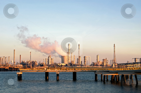 Industrial zone stock photo, Chemical industries and harbour by evening light by Wino Evertz