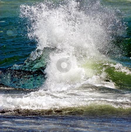 Splashing water in the sea stock photo, Segment of glacier ice in the sea by Wino Evertz