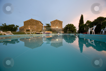 Empty swimming pool at sunset france stock photo, An empty swimming pool at sunset france by Mark Yuill