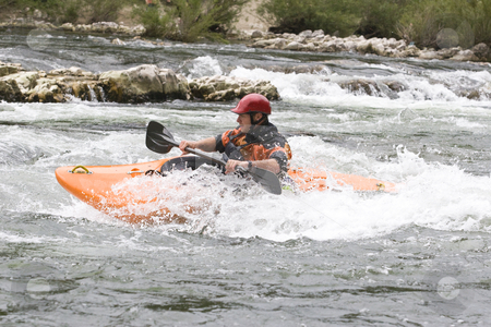 Whitewater kayaking stock photo, Whitewater kayaker surfing a wave on grade 3 rapid by Mark Yuill