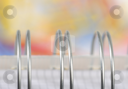 Metal binder stock photo, Metal binder on soft pastel background by Mark Yuill
