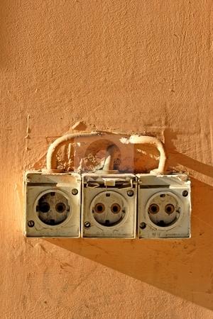 Power socket stock photo, Old power socket by Mark Yuill
