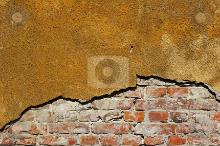 Textures on wall stock photo, Colorful fading paint and plaster on wall by Mark Yuill