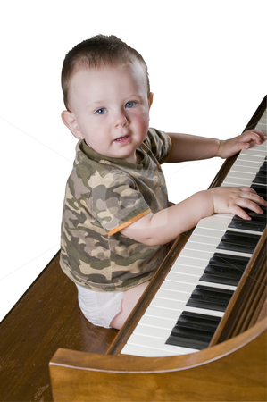 Piano baby Isolated with a clipping path stock photo, Happy little genius playing Chopin. Isolatred with clipping path by RCarner Photography