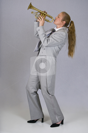 A pretty woman trumpet player stock photo, A woman in a tuxedo plays a trumpet by RCarner Photography