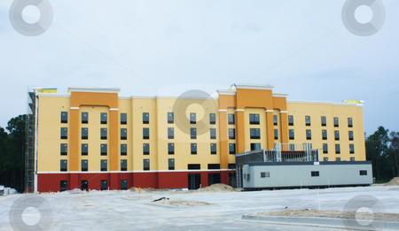 Hotel construction stock photo, Construction site of modern motel near an interstate highway by Lee Barnwell