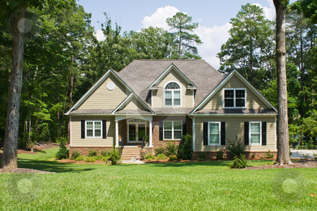 Upscale home on forested lot stock photo, Upscale home with brick, vinyl, and shake siding by Lee Barnwell