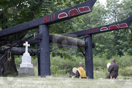 Buddhist Monks prey at grave of Chief  Sealth stock photo, July 10, 2004 :  Buddhist Monks sit and pray at the grave of Chief  Sealth commonly known as Chief Seattle at the Suquamish indian tribe in Suquamish, Washington. by Jesse Beals