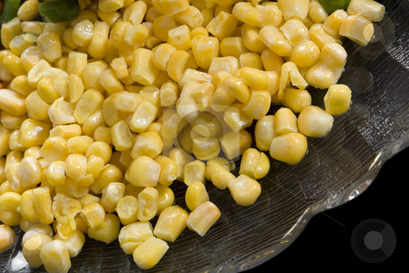 Precooked corn on a glass dish stock photo, Precooked corn on a glass dish on a black background by Paulo Resende
