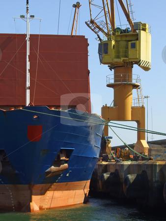 Big ship unloading in dock stock photo, Big ship unloading in dock by Paulo Resende