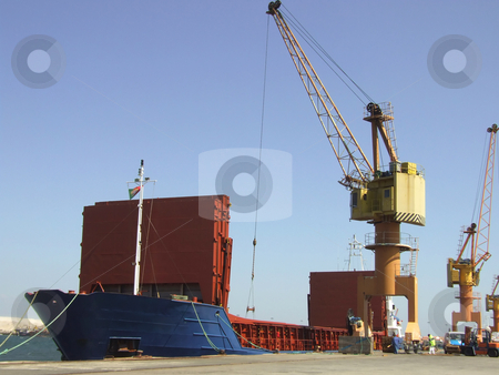 Big ship unloading in dock stock photo, Big ship unloading in dock by Paulo Resende