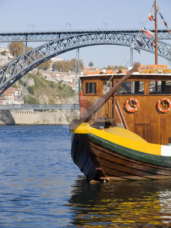 Tradicional boat at Porto stock photo, Cityscape with a typical portowine boat in the forground by Paulo Resende