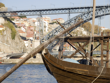 Tradicional rebelo boat stock photo, Cityscape with a typical portowine rebelo boat in the forground by Paulo Resende