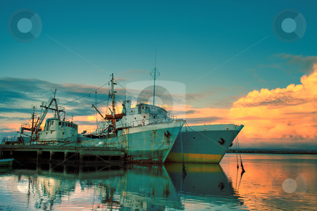 Old tankers in the sunset stock photo, Old tankers in the sunset by Paulo Resende