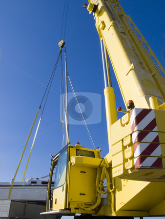 Autocrane unload a ship stock photo, Autocrane unload a sail ship into water by Paulo Resende