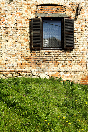 Old window stock photo, Old window in brick wall by Mark Yuill