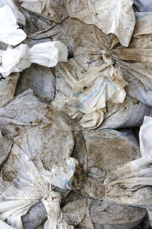 Sandbags stock photo, Flood defence sandbags by Mark Yuill