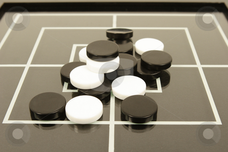Black and white board game stock photo, draughs or checkers black and white board game by Mark Yuill