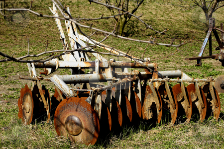 Old plough stock photo, Old plough in field by Mark Yuill