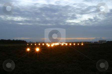 View from the end of a runway stock photo, View from the end of a runway at dusk by Mark Yuill