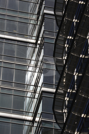 Modern office building stock photo, Reflection, shapes and textures of modern office building by Mark Yuill
