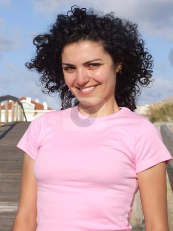 Woman walking on the beach on sidewalk stock photo, Woman walking on the beach on sidewalk by Paulo Resende