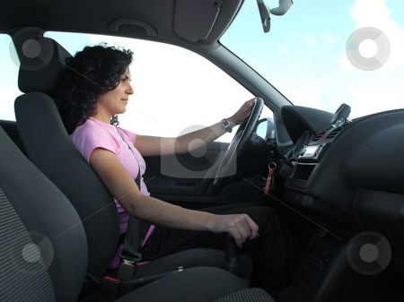 Woman driving stock photo, Woman driving car with detail of interior car by Paulo Resende