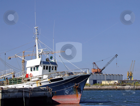 Fishing boat on dock stock photo, Detail from a fishing boat on dock by Paulo Resende