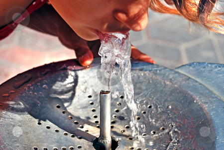 Drinking from water fountain stock photo, Girl drinking on water fountain outdoor close up by Julija Sapic