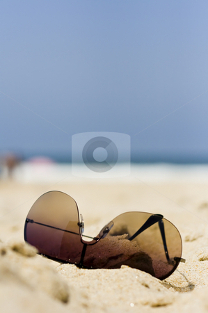 Summer Vacation stock photo, Sunglasses into the beach sand by Paulo Resende