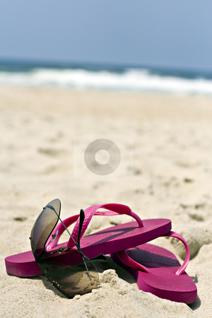 Flip flops and sunglasses  stock photo, Sunglasses and pink flip flops in the sand by Paulo Resende