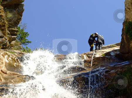 Prepering for rappel  stock photo, Couple prepering to descende a waterfall with roupes by Paulo Resende