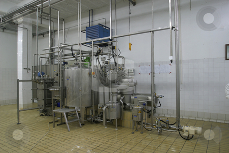 Temperature controlled tanks and pipes in modern dairy stock photo, Stainless steel temperature controlled tanks and pipes in modern dairy by Mark Yuill